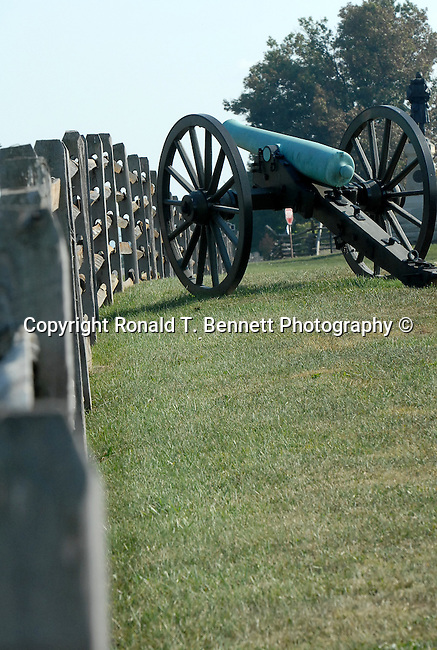 """Civil war cannon and fence Maryland, Old Line State, Free State, Maryland, Mid Atlantic region, Seventh state to ratify the United States Constitution, Old Line State, Free State, Johns Hopkins University, Little America, State of Maryland United States of America, Baltimore, Oak forest, Piedmont Region, Pine groves in the mountains to the west, Chesapeake Bay, Severn River, temporary capital of the United States in 1783-1784, Annapolis Peace Conference, Province of Maryland, """"Town at Proctor's,"""" Fine Art Photography by Ron Bennett, Fine Art, Fine Art photography, Art Photography, Copyright RonBennettPhotography.com ©"""