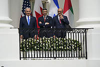 "From left to right: Prime Minister Benjamin Netanyahu of Israel; Sheikh Abdullah bin Zayed bin Sultan Al Nahyan, Minister of Foreign Affairs and International Cooperation of the United Arab Emirates; and Dr. Abdullatif bin Rashid Alzayani, Minister of Foreign Affairs, Kingdom of Bahrain look on as United States President Donald J. Trump makes remarks at a signing ceremony of the ""Abraham Accords"" on the South Lawn of the White House in Washington, DC on Tuesday, September 15, 2020. <br /> Credit: Chris Kleponis / Pool via CNP /MediaPunch"