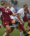 Florida State's Kirsten van de Ven (14) puts her foot into the chest of Duke goalkeeper Allison Lipsher (below, right) as Rebekah Fergusson (24) watches on Sunday, October 22nd, 2006 at Koskinen Stadium in Durham, North Carolina. The Duke Blue Devils defeated the Florida State University Seminoles 3-1 in an Atlantic Coast Conference NCAA Division I Women's Soccer game.