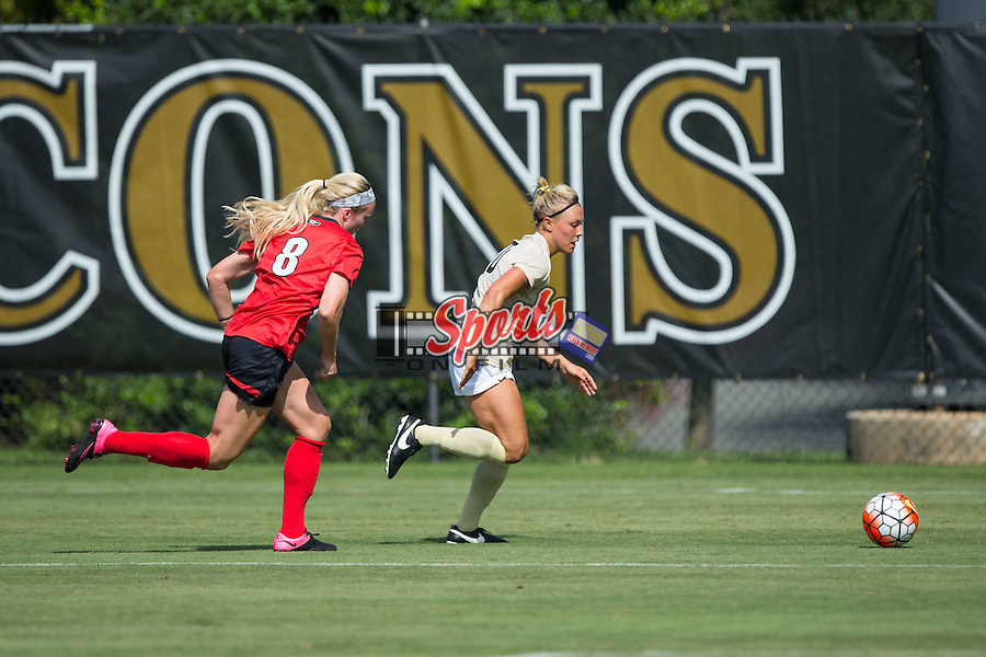 Lizzy Kinkler (10) of the Wake Forest Demon Deacons keeps the ball away from Caroline Waters (8) of the Georgia Bulldogs during first half action at Spry Soccer Stadium on August 23, 2015 in Winston-Salem, North Carolina.  The Deacons defeated the Bulldogs 4-0.  (Brian Westerholt/Sports On Film)