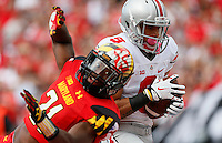 Ohio State Buckeyes wide receiver Devin Smith (9) Ohio State Buckeyes place kicker Tim Scott (9) scores a touchdown when Maryland Terrapins defensive back Sean Davis (21) fails to tackle him in the third quarter of their game at Byrd Stadium in College Park, Maryland on October 4, 2014. (Columbus Dispatch photo by Brooke LaValley)