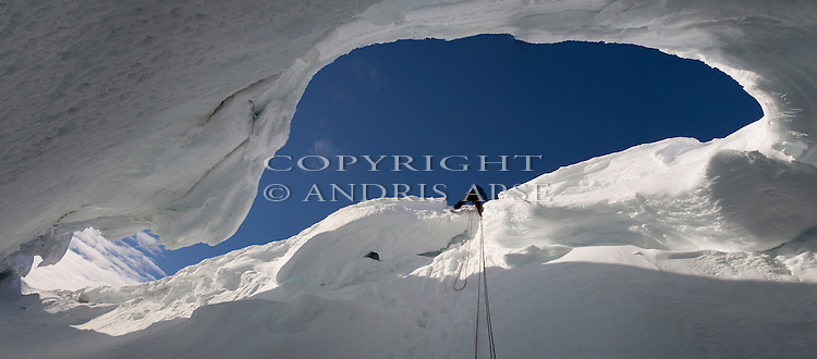 Climbing out of a crevasse on Ross Island Antarctica.