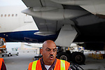 Michael Gaston answers questions after unloading cargo from a Delta 777 flight that recently arrived from Johannesburg, South Africa at Gate F8 outside of the Maynard H. Jackson Jr. International Terminal at Hartsfield–Jackson Atlanta International Airport, in Atlanta, Georgia on August 28, 2013.