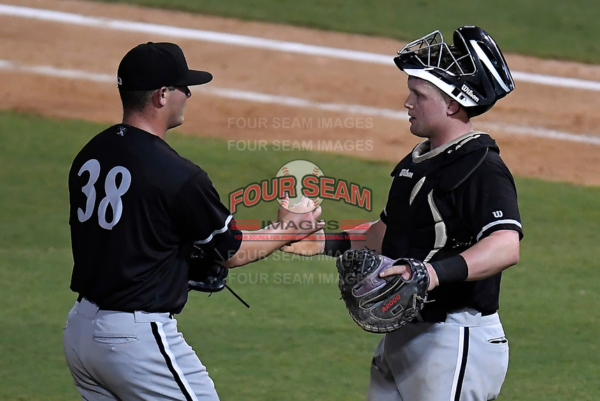 Closer Matthew Foster (38) of the Kannapolis Intimidators, left, shakes hands with catcher Evan Skoug (14) after recording the final out in Game 3 of the South Atlantic League Championship series against the Greenville Drive on Thursday, September 14, 2017, at Fluor Field at the West End in Greenville, South Carolina. Kannapolis won, 5-4. Greenville leads the series 2-1. (Tom Priddy/Four Seam Images)