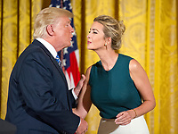 United States President Donald J. Trump kisses his daughter Ivanka after making remarks at a event with small businesses in the East Room of the White House in Washington, DC on Tuesday, August 1, 2017. Photo Credit: Ron Sachs/CNP/AdMedia
