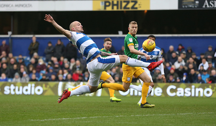 Queens Park Rangers' Toni Leistner clears ahead of Preston North End's Jayden Stockley<br /> <br /> Photographer Rob Newell/CameraSport<br /> <br /> The EFL Sky Bet Championship - Queens Park Rangers v Preston North End - Saturday 19 January 2019 - Loftus Road - London<br /> <br /> World Copyright &copy; 2019 CameraSport. All rights reserved. 43 Linden Ave. Countesthorpe. Leicester. England. LE8 5PG - Tel: +44 (0) 116 277 4147 - admin@camerasport.com - www.camerasport.com