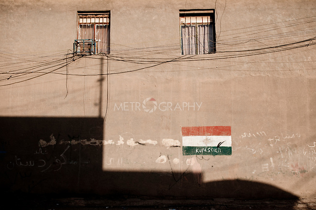 KIRKUK, IRAQ: The Kurdish flag is painted on a wall in the Azadi neighborhood of Kirkuk ..Kirkuk, the oil-rich city in northern Iraq, is home to Kurds, Arabs, Turkomen, Christians, Kakayi, and numerous other ethnicities. Since 2003, thousands of its residents have been killed or injured in terrorist attacks...As the US military leaves Iraq, the future of this violent and ethnically diverse city remains unsure...Photo by Pazhar Mohammad/Metrography