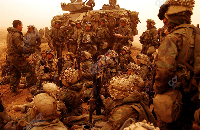 A company of US marines received a talk from their lieutenant at their position in central Iraq as they headed further north towards Baghdad. March 26, 2003