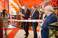 New York Mayor Bill de Blasio, left, and Junior's co-owner Alan Rosen, right, cut the ribbon at the ceremonial opening of the second Times Square branch of Junior's Restaurant. in the former Ruby Foo's space, on Monday, June 26, 2017. The original Junior's is located in Downtown Brooklyn and is beloved for it's famous cheesecake. Junior's has opened a second space in Times Square in the now closed Ruby Foo's location. The new restaurant seats 300 people. (© Richard B. Levine)