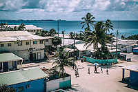 People on a street of Ebeye-town. Ebeye Island, an area of only 0.36 square kilometres, has a population of more than 13 thousand people, many of whom were relocated from other atolls as a result of nuclear testing that the American military began to conduct post WWII. Ebeye subsequently became overpopulated and is informally known as the 'slum of the Pacific'. It people suffer numerous diseases and the mortality rate is one of the highest in the Republic of the Marshall Islands.