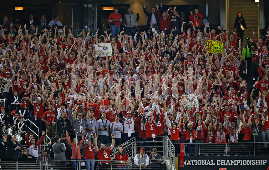 Ohio State Buckeyes fans cheer after Ohio State Buckeyes running back Ezekiel Elliott (15) scored a touchdown run during the 3rd quarter against Oregon Ducks in College Football Playoff Championship game at AT&T Stadium in Arlington, Texas on January 12, 2015.  (Dispatch photo by Kyle Robertson)