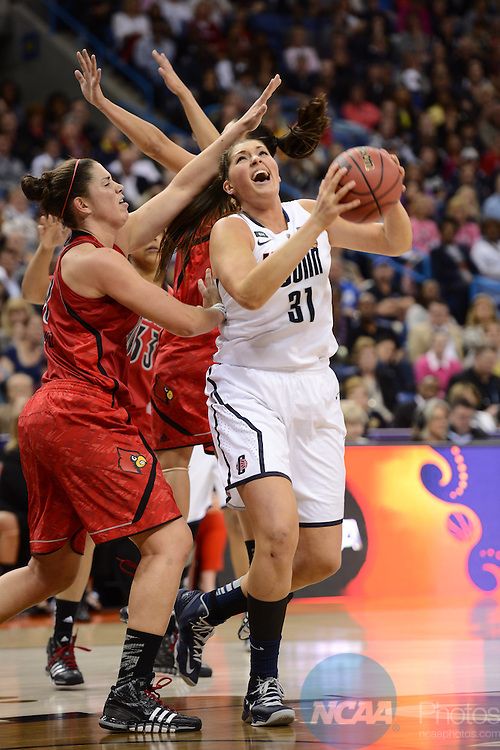 09 APR 2013: Stefanie Dolson (31) and Sara Hammond (00) battle for the ball during the Division I Women's Basketball Championship held at the New Orleans Arena in New Orleans, LA. UCONN Defeated Louisville 93-60 to claim the national title. Stephen Nowland/NCAA Photos