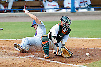 June 05, 2011:    Florida Gators outfielder Daniel Pigott (8) slides into home plate in front of the tag of Miami Hurricanes catcher Shane Rowland (24) during NCAA Gainesville Regional action between Florida Gators and Miami Hurricanes played at Alfred A. McKethan Stadium on the campus of Florida University in Gainesville, Florida.   Florida defeated Miami 11-4.........