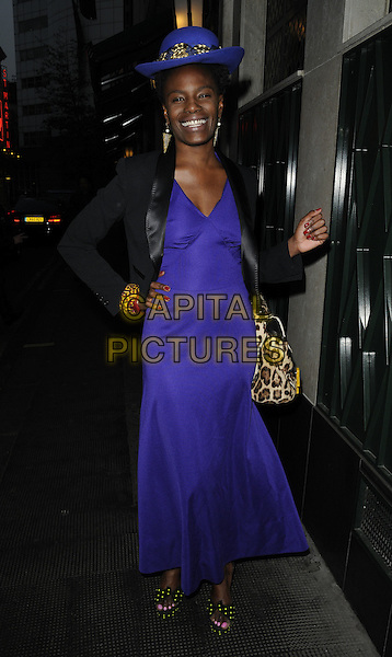 SHINGAI SHONIWA  .The Jennifer Hudson new album launch party, The Ivy Club, London, England..April 20th, 2011.full length purple maxi dress black jacket beige leopard print bag purse hat hand on hip.CAP/CAN.©Can Nguyen/Capital Pictures.