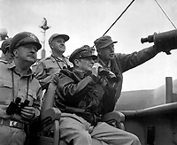 Brig. Gen. Courtney Whitney; Gen. Douglas MacArthur, Commander in Chief of U.N. Forces; and Maj. Gen. Edward M. Almond observe the shelling of Inchon from the U.S.S. Mt. McKinley, September 15, 1950.  Nutter (Army)<br /> NARA FILE #:  111-SC-348438<br /> WAR & CONFLICT BOOK #:  1374
