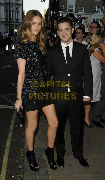 ROSIE HUNTINGDON-WHITELEY & TY WOOD.Glamour Women of the Year Awards 2009 at Berkeley Square Gardens, London, England. .June 2nd, 2009 .Tyson full length couple tall short suit tie black dress ankle boots heels platform platforms clutch .CAP/CAN.©Can Nguyen/Capital Pictures.