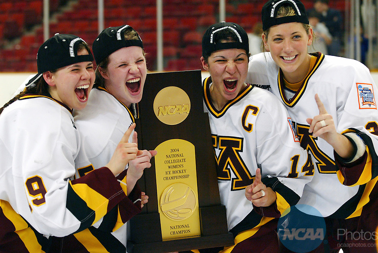28 MAR 2004:  Minnesota celebrates their victory over Harvard during the Division I Women's Ice Hockey Championship held at the Dunkin Donuts Center in Providence, RI.  Minnesota defeated Harvard 6-2 for the national title.  Jamie Schwaberow/NCAA Photos