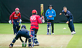 ICC World T20 Qualifier (Warm up match) - Scotland V Jersey at Heriots CC, Edinburgh - Scotland spinner Mark Watt sneds down a delivery past Umpire Nigel Long — credit @ICC/Donald MacLeod - 06.7.15 - 07702 319 738 -clanmacleod@btinternet.com - www.donald-macleod.com