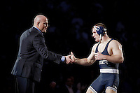 STATE COLLEGE, PA - FEBRUARY 8: Matt Brown of the Penn State Nittany Lions is congratulated by head coach Cael Sanderson after winning his match on February 8, 2015 at the Bryce Jordan Center on the campus of Penn State University in State College, Pennsylvania. The Hawkeyes won 18-12. (Photo by Hunter Martin/Getty Images) *** Local Caption *** Matt Brown;Cael Sanderson