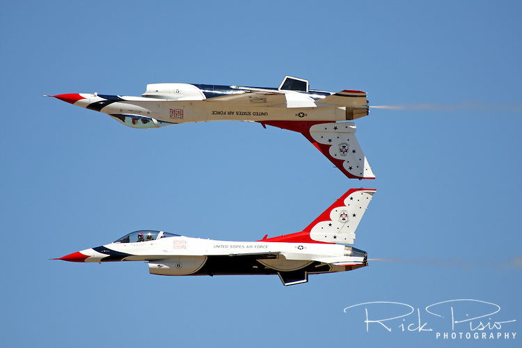 The United States Air Force Thunderbirds Lead and Opposing Solo aircraft (#5 and #6) perform the Calypso Pass during a flight demonstration at the 2008 Reno National Championship Air Races at Stead Field in Nevada. The Thunderbirds were formed in 1956 and have been flying the F-16C Fighting Falcon since 1992.
