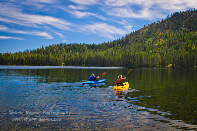 Two men kayaking on Gold Lake, Lakes Basin, Northern California.