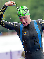 07 AUG 2012 - LONDON, GBR - Alistair Brownlee (GBR) of Great Britain leaves the water at the end of the swim at the men's London 2012 Olympic Games Triathlon  in Hyde Park, London, Great Britain .(PHOTO (C) 2012 NIGEL FARROW)