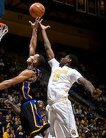 Roger Moute a Bidias of California tries to rebound a loose ball during the game against Coppin State at Haas Pavilion in Berkeley, California on November 8th, 2013.    California defeated Coppin State, 83-64.