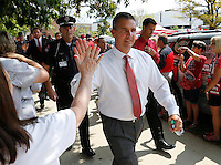 Ohio State Buckeyes head coach Urban Meyer high fives fans on his way to into the Skull Session prior to the NCAA football game against San Diego State at Ohio Stadium in Columbus on Sept. 7, 2013. (Adam Cairns / The Columbus Dispatch)