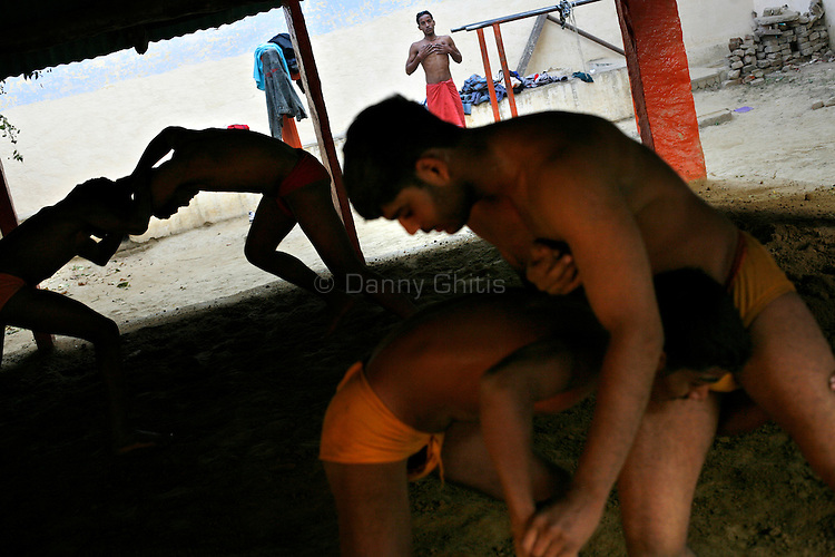 The small arena brings young men from different castes together whereas they might never interact in the real world. The ancient tradition of Indian wrestling, known as  kushti, thrives in Varanasi, one of the world's oldest cities. Wrestling gyms, or akhara, scattered around the city are of the few places where Hindu men from different casts are considered equals. Aside from bodybuilding, practiioners emphasize a life of discipline and celibacy. But as modernity sweeps India and Western sports like cricket become more popular, some akhara are being abandoned. While some prominent, government-run gyms switched to mats for Olympic-style wrestling, akhara in villages and towns maintain the old ways.