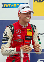Mick Schumacher (CHE) of Prema Theodore Racing celebrates his win on the podium during the F3 European race during the 2018 Silverstone - FIA World Endurance Championship at Silverstone Circuit, Towcester, England on 18 August 2018. Photo by Vince  Mignott.