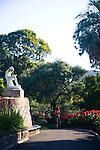 "The Royal Botanic Gardens in Sydney, Australia, are the largest of three major botanical gardens open to the public in Sydney and are free to access and open every day of the year. The ""Boy with Thorn"" statue in the gardens."