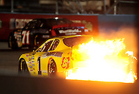 Apr 16, 2009; Avondale, AZ, USA; NASCAR Camping World Series West driver Jim Inglebright drives in flames after blowing an engine during the Jimmie Johnson Foundation 150 at Phoenix International Raceway. Mandatory Credit: Mark J. Rebilas-