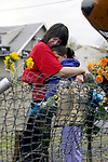 &quot; MEMORIAL&quot;  MAY 5,2004<br /> Barbi Brennan (left) is consoled by her daughter 11 yr old Kaitlyn both of Cliffwood Beach at the scene of an automoblie crash which killed Brennan's niece 17 yr old South Amboy High School student Jessica Ruskuski on Sunday night. The accident occured on Rt 35 North, just over the drawbridge into Sayreville.