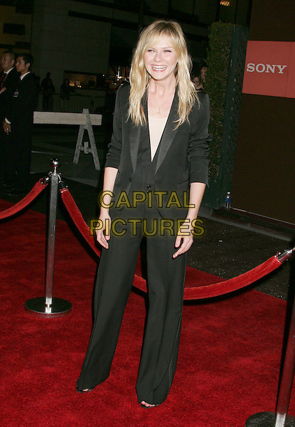 KIRSTEN DUNST.Sony Global Marketing Partners Conference Closing Celebration held on Rodeo Drive, Beverly Hills, California, USA,29 September 2006..full length black trouser suit jacket fringe funny.Ref: ADM/RE.www.capitalpictures.com.sales@capitalpictures.com.©Russ Elliot/AdMedia/Capital Pictures.