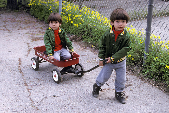 Berkeley CA Latino identical twin boys, four-year-old  playing together at bilingual Spanish English preschool