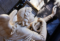 An angelic sculpture decorates a tomb in the Cementario de la Recoleta in the Recoleta Barrio of Buenos Aires, Argentina.