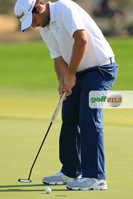 Alexander Levy (FRA) putts on the 1st green during Friday's Round 2 of the Abu Dhabi HSBC Golf Championship 2015 held at the Abu Dhabi Golf Course, United Arab Emirates. 16th January 2015.<br /> Picture: Eoin Clarke www.golffile.ie