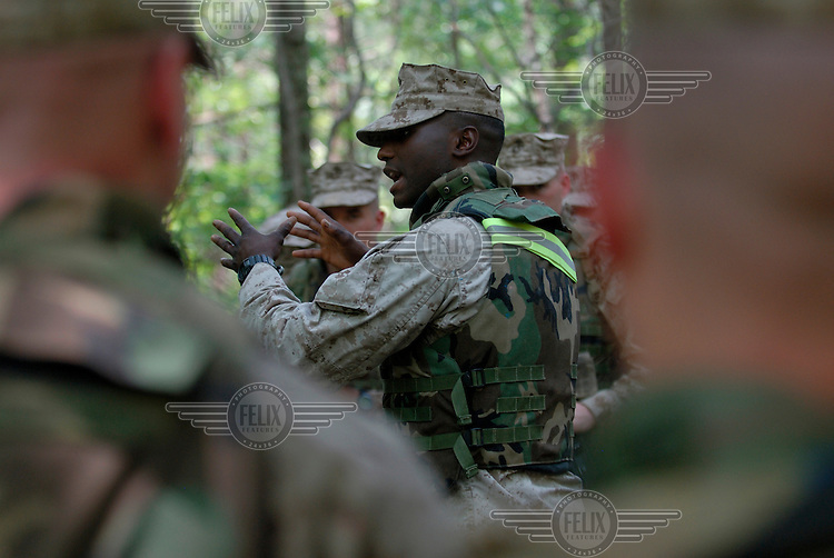 Marine officers in debriefing after training exercise in assaulting an 'insurgent' held village. The Basic School at Camp Barrett, Quantico, Virginia is where all incoming Marine officers are trained. Seven companies of about 300 officers come through every year.