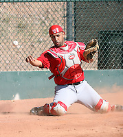 Jose Jimenez #94 of the Los Angeles Angels participates in catchers fielding drills during spring training workouts at the Angels complex on February 22, 2011  in Tempe, Arizona. .Photo by:  Bill Mitchell/Four Seam Images.