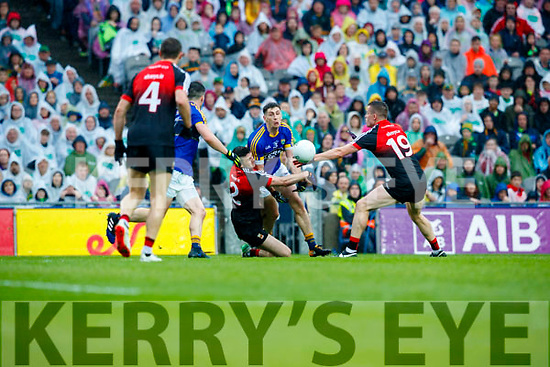 Paul Geaney Kerry in action against Brendan Harrison and Stephen Coen Mayo in the All Ireland Semi Final in Croke Park on Sunday.
