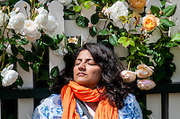 Tuesday 31 May 2016. Hay on Wye, UK<br /> Pictured:  A woman relaxed in the the sun amongst some roses <br /> Re: The 2016 Hay festival take place at Hay on Wye, Powys, Wales