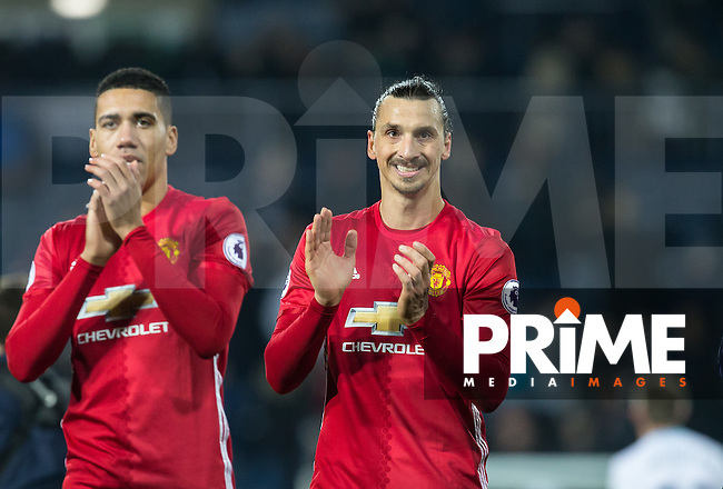 Zlatan Ibrahimovic & Chris Smalling of Manchester United  applaud the support during the EPL - Premier League match between West Bromwich Albion and Manchester United at The Hawthorns, West Bromwich, England on 17 December 2016. Photo by Andy Rowland / PRiME Media Images.