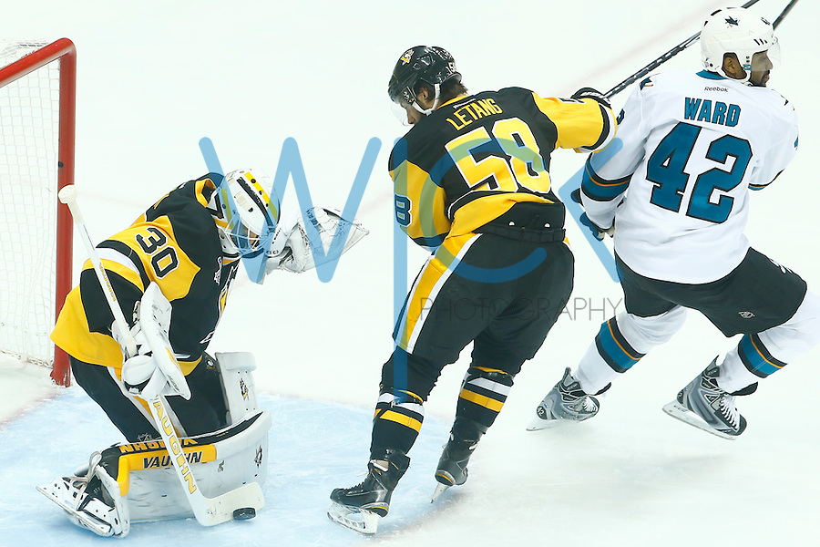 Matt Murray #30 of the Pittsburgh Penguins makes a save in front of Joel Ward #42 of the San Jose Sharks in the first period during game two of the Stanley Cup Final at Consol Energy Center in Pittsburgh, Pennslyvania on June 1, 2016. (Photo by Jared Wickerham / DKPS)