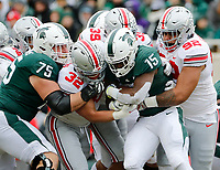Ohio State Buckeyes linebacker Tuf Borland (32) runs through Michigan State Spartans guard Kevin Jarvis (75) to tackle Michigan State Spartans running back La'Darius Jefferson (15) with the help from Ohio State Buckeyes defensive tackle Haskell Garrett (92) during the first quarter of the NCAA football game at Spartan Stadium in East Lansing, Mich. on Nov. 10, 2018. [Adam Cairns/Dispatch]