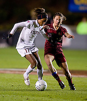 Lindsay Taylor (17) of Stanford sprints away from Victoria DiMartino (1) of Boston College during the second game of the NCAA Women's College Cup at WakeMed Soccer Park in Cary, NC.  Stanford defeated Boston College, 2-0.