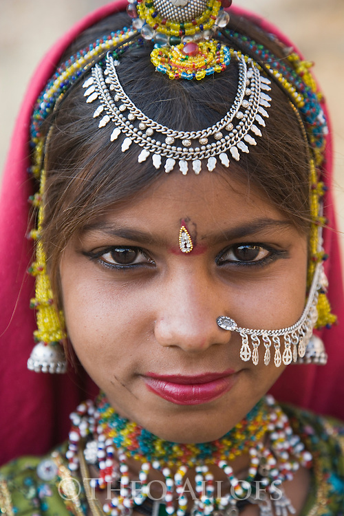 Rajasthani girl with colorful head dress and elaborate jewelry, Jaisalmer, Rajasthan, India --- Model Released