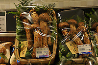 Four fresh matsutake mushrooms found wild in the mountains sell for 73000 yen, approximately 250 pounds sterling in the Isetan epartment Store in Central Tokyo, Japan. September 1st, 2008.<br />