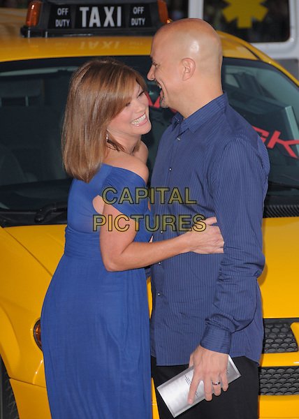 "VALERIE BERTINELLI & TOM VITALE.The Columbia Pictures' L.A. Premiere of ""Hancock"" held at The Chinese Theatre in Hollywood, California, USA..June 30th, 2008                                                                     .half length blue off the shoulder dress hug embrace shirt profile couple .CAP/DVS.©Debbie VanStory/Capital Pictures."