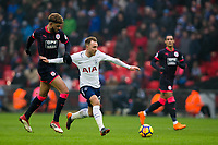Tottenham Hotspur's Christian Eriksen holds off the challenge from Huddersfield Town's Philip Billing <br /> <br /> Photographer Craig Mercer/CameraSport<br /> <br /> The Premier League - Tottenham Hotspur v Huddersfield Town - Saturday 3rd March 2018 - Wembley Stadium - London<br /> <br /> World Copyright &copy; 2018 CameraSport. All rights reserved. 43 Linden Ave. Countesthorpe. Leicester. England. LE8 5PG - Tel: +44 (0) 116 277 4147 - admin@camerasport.com - www.camerasport.com