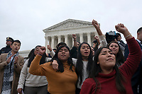 People raise their fists as they depart the Supreme Court after hearing arguments on the Deferred Action for Childhood Arrivals program in Washington D.C., U.S. on Tuesday, November 12, 2019.<br /> <br /> Credit: Stefani Reynolds / CNP /MediaPunch